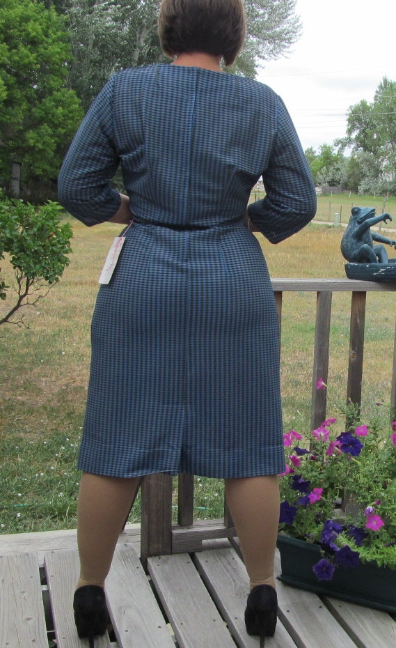 1950s vintage bombshell dress in blue and back - this is the back view