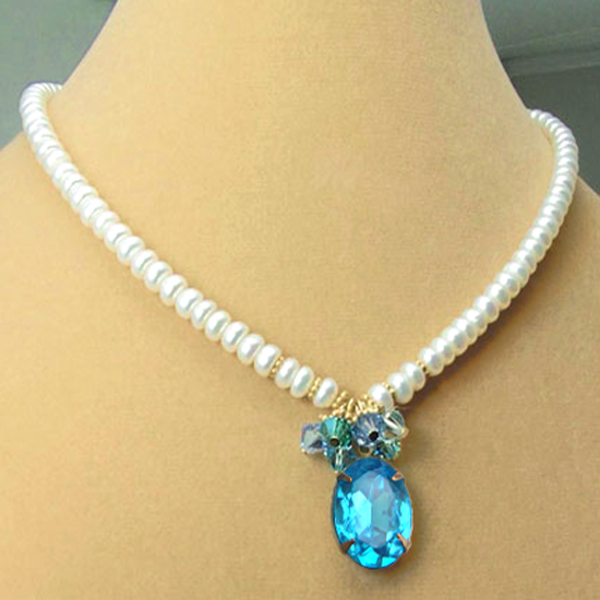 DIY necklace  design idea featuring white freshwater button pearls, Swarovski crystal elements and an aqua oval rhinestone pendant