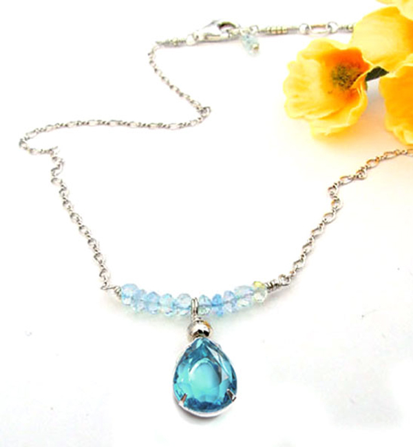 DIY necklace design idea featuring cable chain and a faceted teardrop pendant