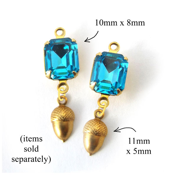 earrings design idea featuring raw brass acorn charms and faceted small octagon glass gems