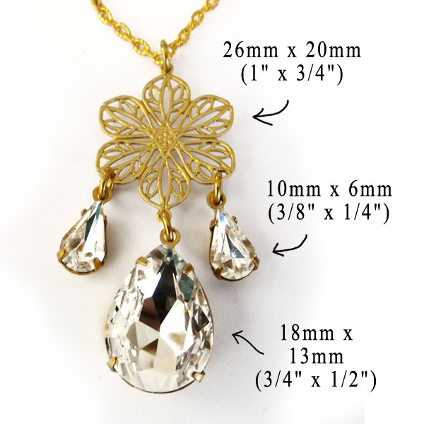 bridal necklace with crystal teardrops and brass filigree flower charm