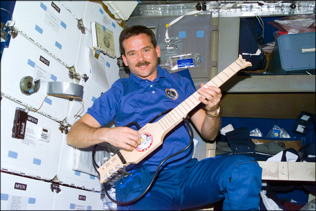 Chris Hadfield and guitar - on the ISS