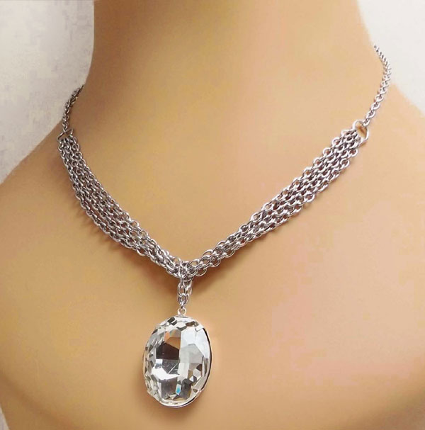 crystal oval rhinestone necklace with multiple strands of stainless steel chain