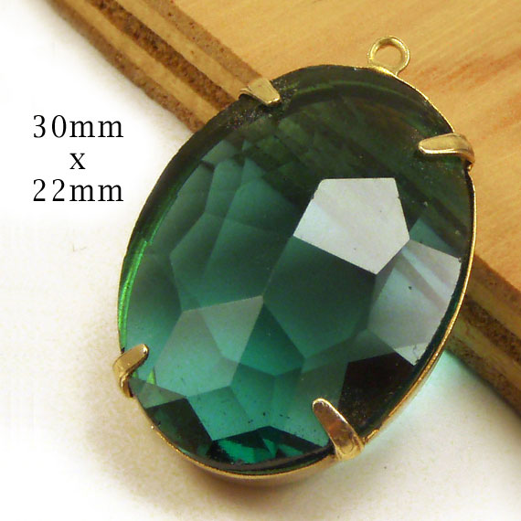 emerald sheer glass pendant jewel in a golden brass setting