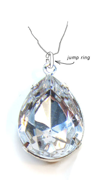 a jump ring being used to attach a pendant to a chain