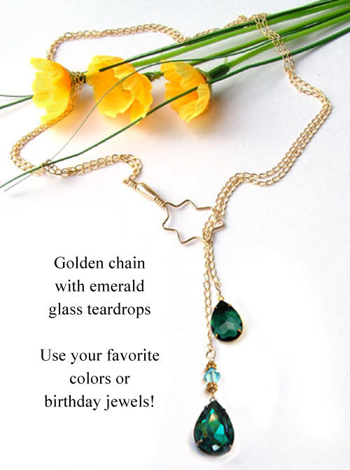 lariat necklace design idea featuring golden chain and emerald glass teardrops