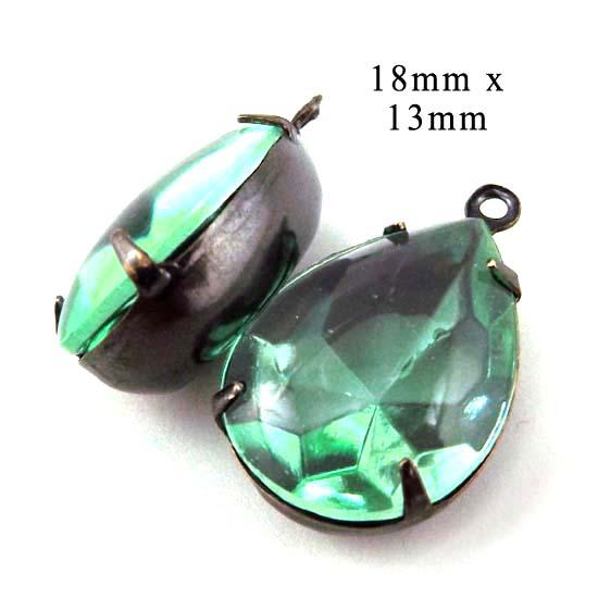 peridot glass jewels in blackened brass settings