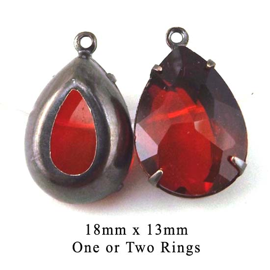 red glass jewels in black brass settings