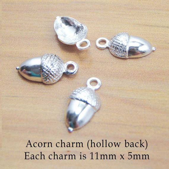 silver acorn charms two pairs showing hollow back