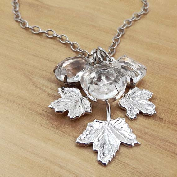 necklace with silver leaf and clear glass jewels