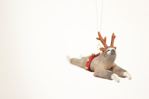 sloth christmas ornament wearing reindeer antlers...from Curious Burrow