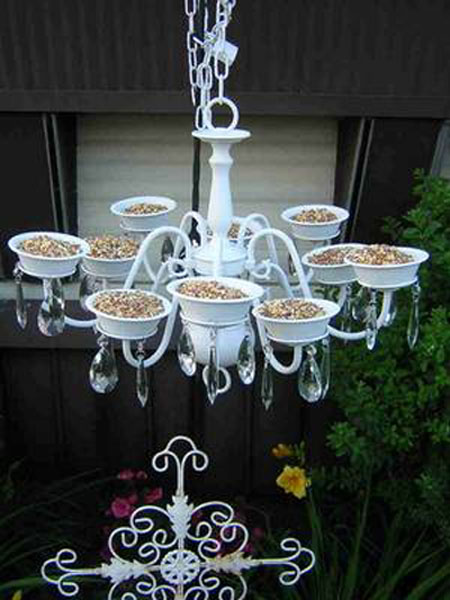Vintage Chandelier becomes backyard bird feeder